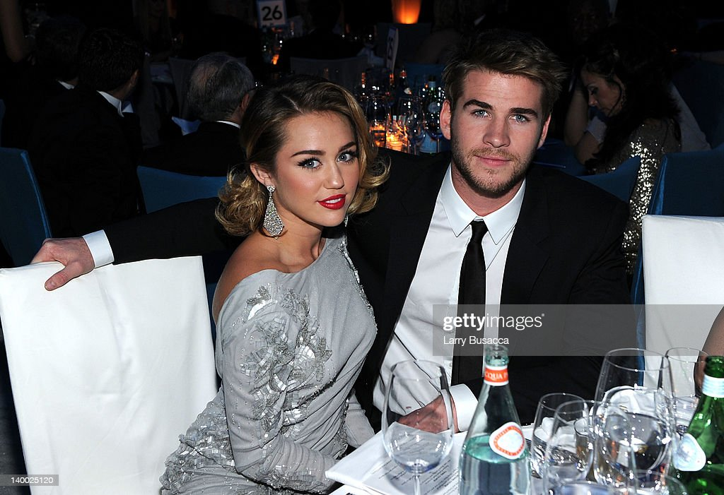 Singer <a gi-track='captionPersonalityLinkClicked' href=/galleries/search?phrase=Miley+Cyrus&family=editorial&specificpeople=3973523 ng-click='$event.stopPropagation()'>Miley Cyrus</a> and actor <a gi-track='captionPersonalityLinkClicked' href=/galleries/search?phrase=Liam+Hemsworth&family=editorial&specificpeople=6338547 ng-click='$event.stopPropagation()'>Liam Hemsworth</a> attend the 20th Annual Elton John AIDS Foundation Academy Awards Viewing Party at The City of West Hollywood Park on February 26, 2012 in Beverly Hills, California.