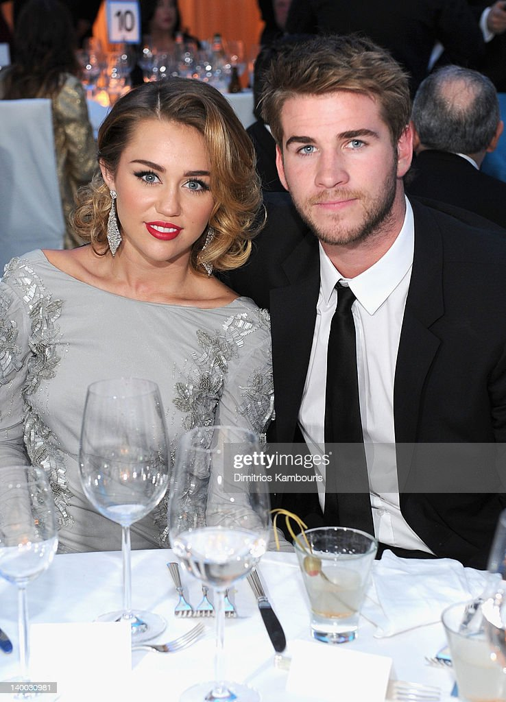 Singer <a gi-track='captionPersonalityLinkClicked' href=/galleries/search?phrase=Miley+Cyrus&family=editorial&specificpeople=3973523 ng-click='$event.stopPropagation()'>Miley Cyrus</a> and Actor Liam Hemsworth attend the 20th Annual Elton John AIDS Foundation Academy Awards Viewing Party at The City of West Hollywood Park on February 26, 2012 in Beverly Hills, California.