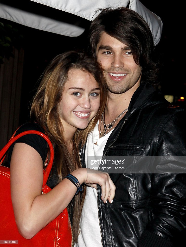 Singer <a gi-track='captionPersonalityLinkClicked' href=/galleries/search?phrase=Miley+Cyrus&family=editorial&specificpeople=3973523 ng-click='$event.stopPropagation()'>Miley Cyrus</a> (L) and model Justin Gaston visit Nubu March 9, 2009 in West Hollywood, California.
