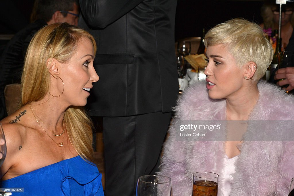 Singer Miley Cyrus (R) and mother Tish Cyrus attend the 56th annual GRAMMY Awards Pre-GRAMMY Gala and Salute to Industry Icons honoring Lucian Grainge at The Beverly Hilton on January 25, 2014 in Los Angeles, California.