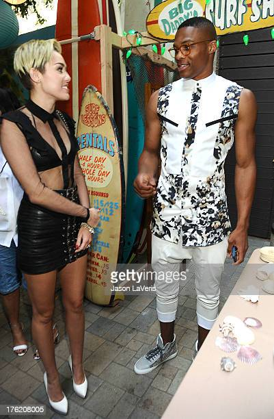Singer Miley Cyrus and NBA player Russell Westbrook pose in the green room at the 2013 Teen Choice Awards at Gibson Amphitheatre on August 11 2013 in...