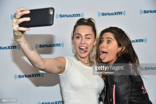Singer Miley Cyrus and SiriusXM host Symon attend the 'Hits 1 In Hollywood' On SiriusXM Hits 1 Channel at The SiriusXM Studios In Los Angeles on May...