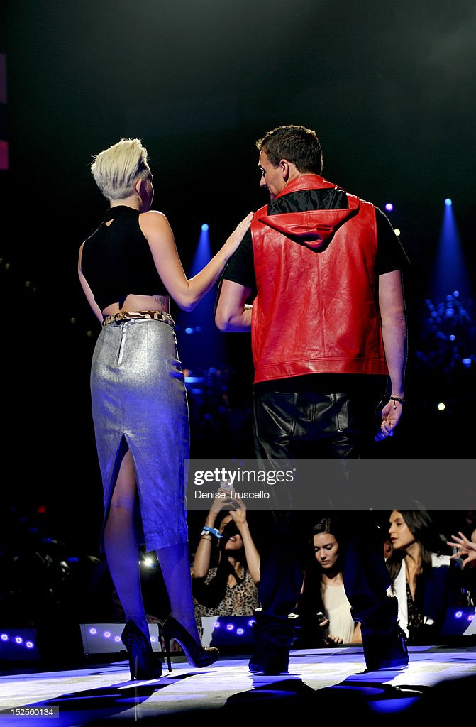 Singer Miley Cyrus and U.S. Olympian Ryan Lochte speak onstage during the 2012 iHeartRadio Music Festival at the MGM Grand Garden Arena on September 21, 2012 in Las Vegas, Nevada.