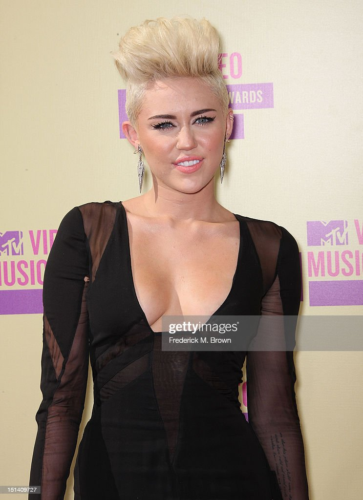 Singer <a gi-track='captionPersonalityLinkClicked' href=/galleries/search?phrase=Miley+Cyrus&family=editorial&specificpeople=3973523 ng-click='$event.stopPropagation()'>Miley Cyrus</a> arrives at the 2012 MTV Video Music Awards at Staples Center on September 6, 2012 in Los Angeles, California.
