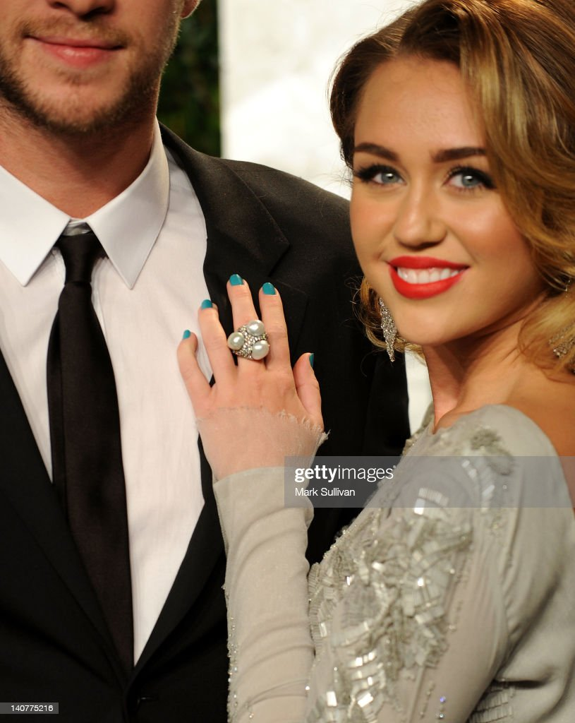 Singer Miley Cyrus (R) arrives at the 2012 Vanity Fair Oscar Party hosted by Graydon Carter at Sunset Tower on February 26, 2012 in West Hollywood, California.