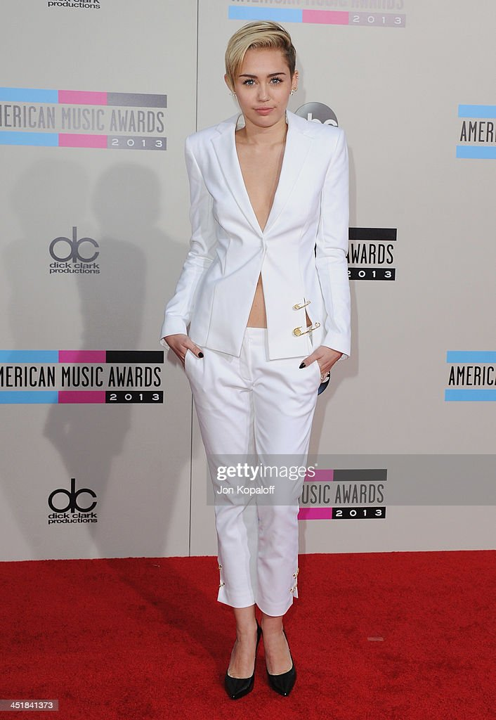 Singer Miley Cyrus arrives at the 2013 American Music Awards at Nokia Theatre L.A. Live on November 24, 2013 in Los Angeles, California.