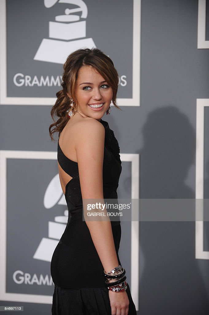 Singer <a gi-track='captionPersonalityLinkClicked' href=/galleries/search?phrase=Miley+Cyrus&family=editorial&specificpeople=3973523 ng-click='$event.stopPropagation()'>Miley Cyrus</a> arrives at the 51st Annual Grammy Awards, at the Staples Center in Los Angeles, on February 8, 2009. AFP PHOTO/GABRIEL BOUYS