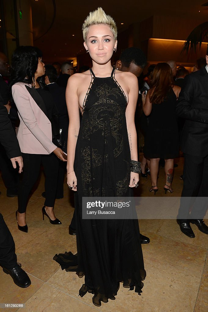 Singer <a gi-track='captionPersonalityLinkClicked' href=/galleries/search?phrase=Miley+Cyrus&family=editorial&specificpeople=3973523 ng-click='$event.stopPropagation()'>Miley Cyrus</a> arrives at the 55th Annual GRAMMY Awards Pre-GRAMMY Gala and Salute to Industry Icons honoring L.A. Reid held at The Beverly Hilton on February 9, 2013 in Los Angeles, California.
