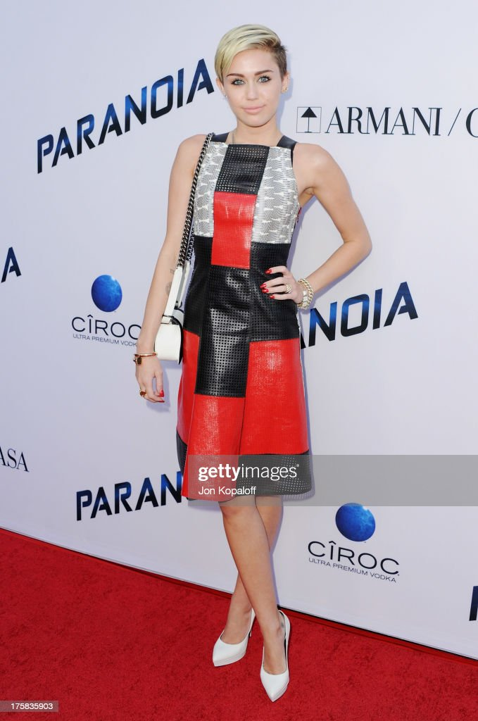 Singer <a gi-track='captionPersonalityLinkClicked' href=/galleries/search?phrase=Miley+Cyrus&family=editorial&specificpeople=3973523 ng-click='$event.stopPropagation()'>Miley Cyrus</a> arrives at the Los Angeles Premiere 'Paranoia' at DGA Theater on August 8, 2013 in Los Angeles, California.