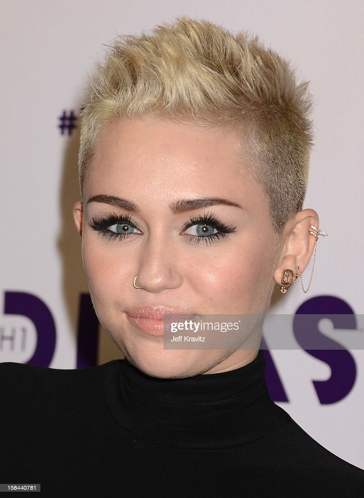Singer <a gi-track='captionPersonalityLinkClicked' href=/galleries/search?phrase=Miley+Cyrus&family=editorial&specificpeople=3973523 ng-click='$event.stopPropagation()'>Miley Cyrus</a> arrives at 'VH1 Divas' 2012 at The Shrine Auditorium on December 16, 2012 in Los Angeles, California.
