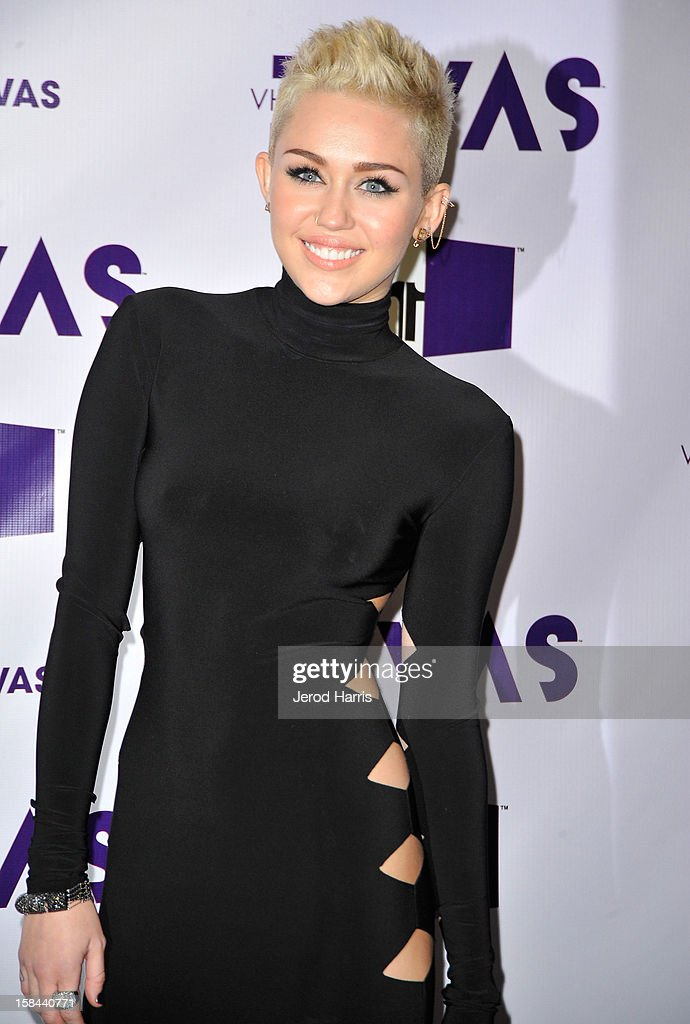 Singer <a gi-track='captionPersonalityLinkClicked' href=/galleries/search?phrase=Miley+Cyrus&family=editorial&specificpeople=3973523 ng-click='$event.stopPropagation()'>Miley Cyrus</a> arrives at 'VH1 Divas' 2012 held at The Shrine Auditorium on December 16, 2012 in Los Angeles, California.