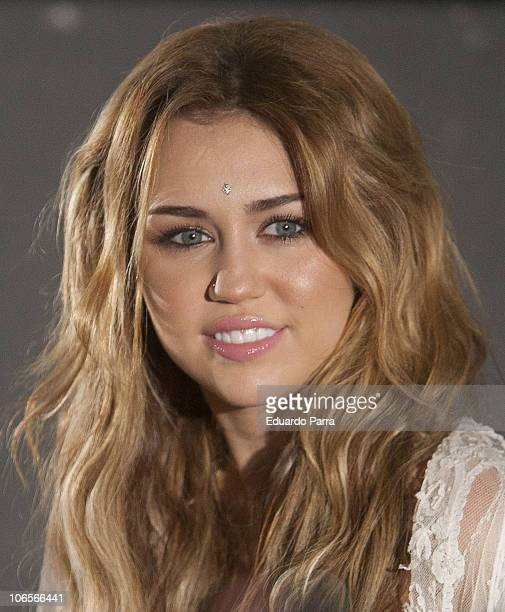 Singer Miley Cyrus attends a meeting with fans at the Ideal cinema on November 5 2010 in Madrid Spain