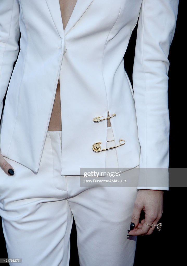 Singer <a gi-track='captionPersonalityLinkClicked' href=/galleries/search?phrase=Miley+Cyrus&family=editorial&specificpeople=3973523 ng-click='$event.stopPropagation()'>Miley Cyrus</a> (fashion detail) attends the 2013 American Music Awards at Nokia Theatre L.A. Live on November 24, 2013 in Los Angeles, California.