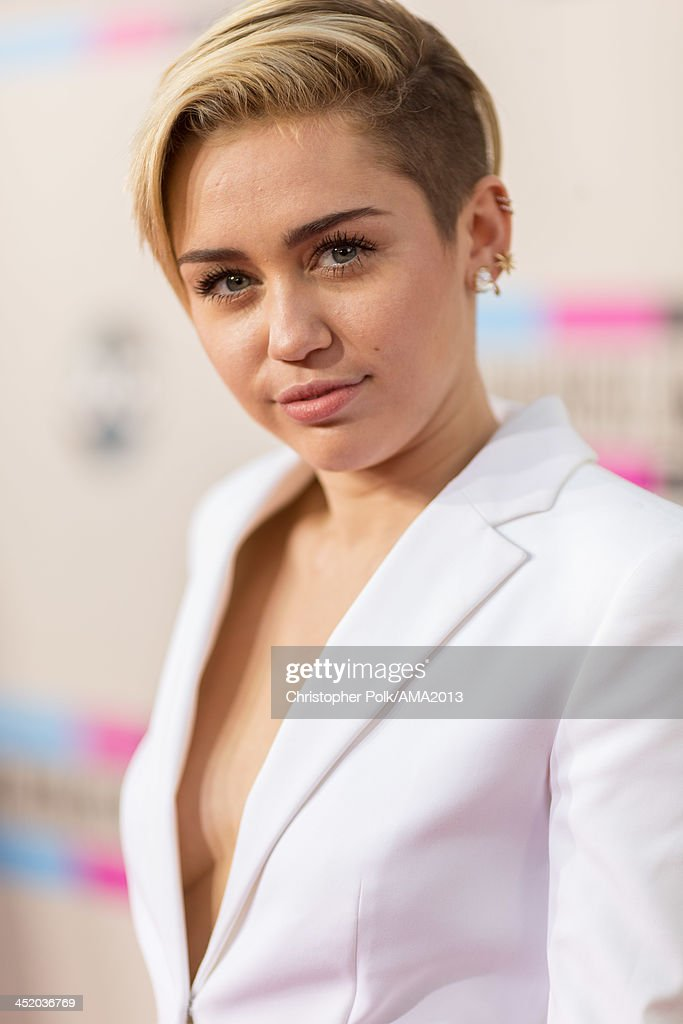 Singer <a gi-track='captionPersonalityLinkClicked' href=/galleries/search?phrase=Miley+Cyrus&family=editorial&specificpeople=3973523 ng-click='$event.stopPropagation()'>Miley Cyrus</a> attends the 2013 American Music Awards at Nokia Theatre L.A. Live on November 24, 2013 in Los Angeles, California.