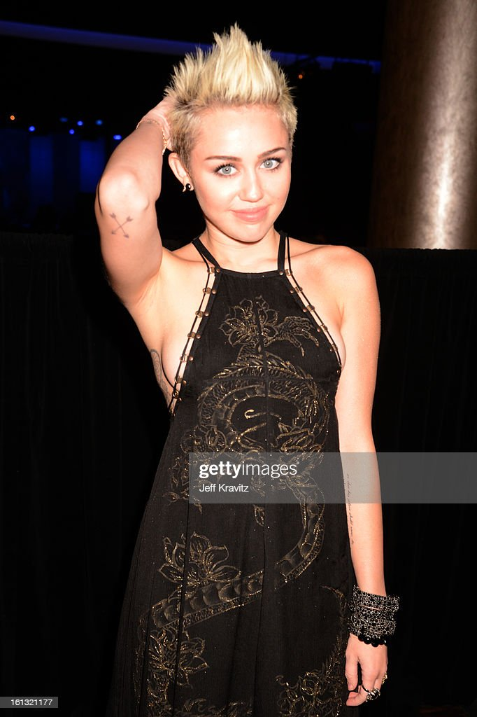 Singer <a gi-track='captionPersonalityLinkClicked' href=/galleries/search?phrase=Miley+Cyrus&family=editorial&specificpeople=3973523 ng-click='$event.stopPropagation()'>Miley Cyrus</a> attends the Clive Davis and The Recording Academy's 2013 GRAMMY Salute to Industry Icons Gala held at The Beverly Hilton Hotel on February 9, 2013 in Beverly Hills, California.