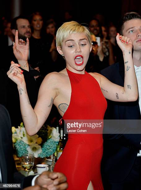 Singer Miley Cyrus attends the PreGRAMMY Gala and Salute to Industry Icons honoring Martin Bandier at The Beverly Hilton Hotel on February 7 2015 in...