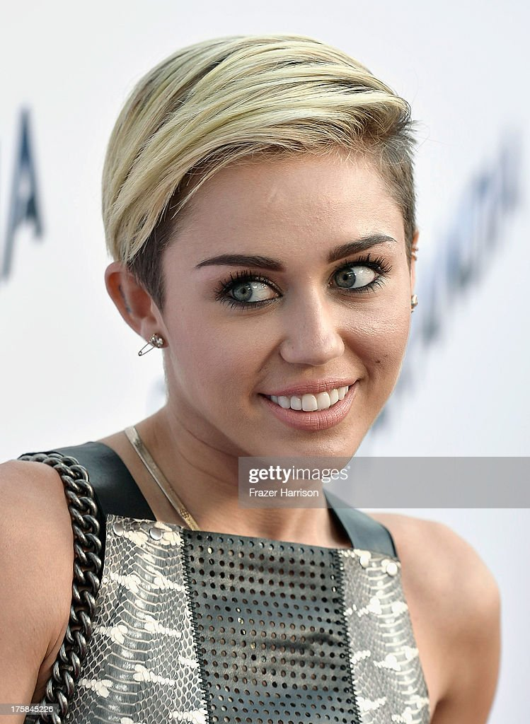 Singer <a gi-track='captionPersonalityLinkClicked' href=/galleries/search?phrase=Miley+Cyrus&family=editorial&specificpeople=3973523 ng-click='$event.stopPropagation()'>Miley Cyrus</a> attends the premiere of Relativity Media's 'Paranoia' at DGA Theater on August 8, 2013 in Los Angeles, California.