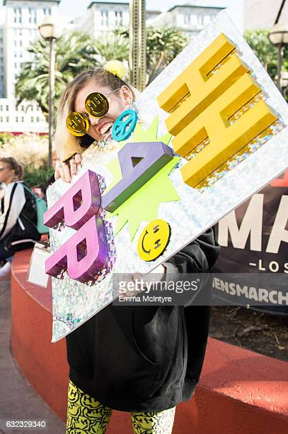 Singer Miley Cyrus attends the women's march in Los Angeles on January 21 2017 in Los Angeles California