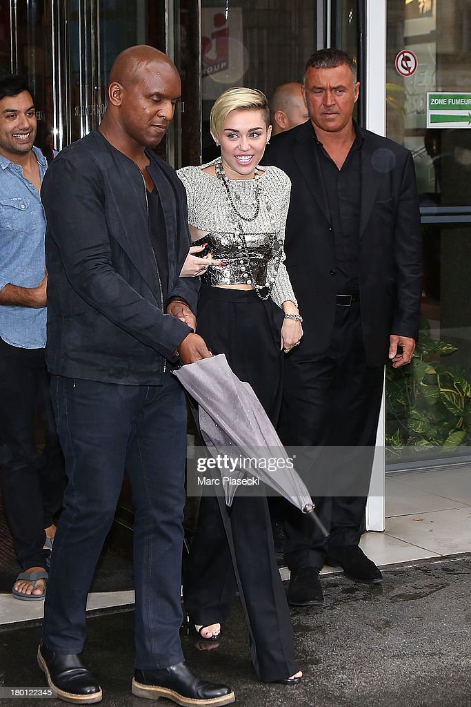 Singer Miley Cyrus is seen leaving the 'NRJ' radio station on September 9, 2013 in Paris, France.