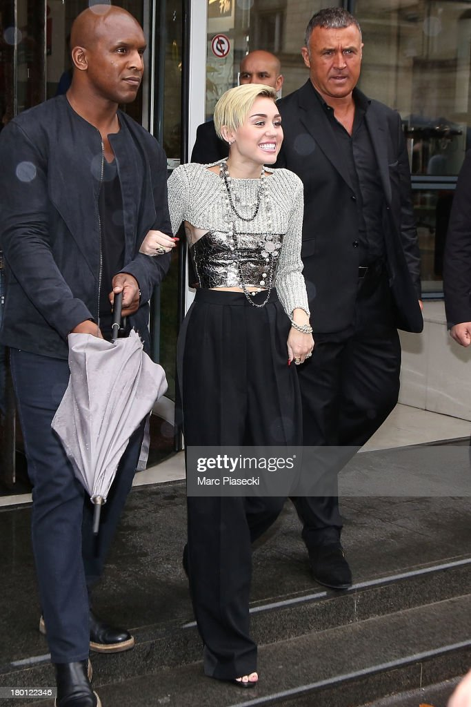 Singer <a gi-track='captionPersonalityLinkClicked' href=/galleries/search?phrase=Miley+Cyrus&family=editorial&specificpeople=3973523 ng-click='$event.stopPropagation()'>Miley Cyrus</a> is seen leaving the 'NRJ' radio station on September 9, 2013 in Paris, France.