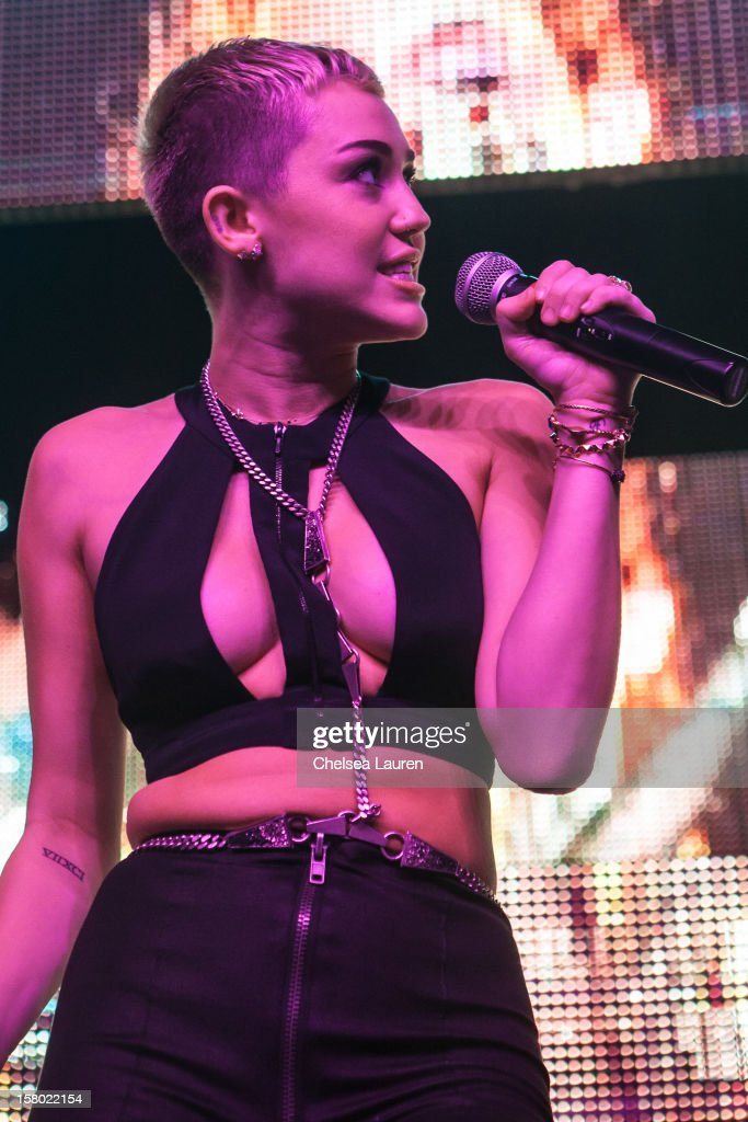 Singer <a gi-track='captionPersonalityLinkClicked' href=/galleries/search?phrase=Miley+Cyrus&family=editorial&specificpeople=3973523 ng-click='$event.stopPropagation()'>Miley Cyrus</a> performs at Borgore's 'Christmas Creampies' concert at Henry Fonda Theater on December 8, 2012 in Hollywood, California.