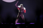Singer Miley Cyrus performs during her Bangerz tour at the Pepsi Center in Denver Colorado on March 4 2014