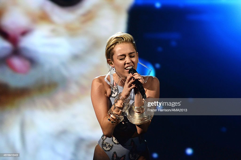 Singer <a gi-track='captionPersonalityLinkClicked' href=/galleries/search?phrase=Miley+Cyrus&family=editorial&specificpeople=3973523 ng-click='$event.stopPropagation()'>Miley Cyrus</a> performs onstage during the 2013 American Music Awards at Nokia Theatre L.A. Live on November 24, 2013 in Los Angeles, California.