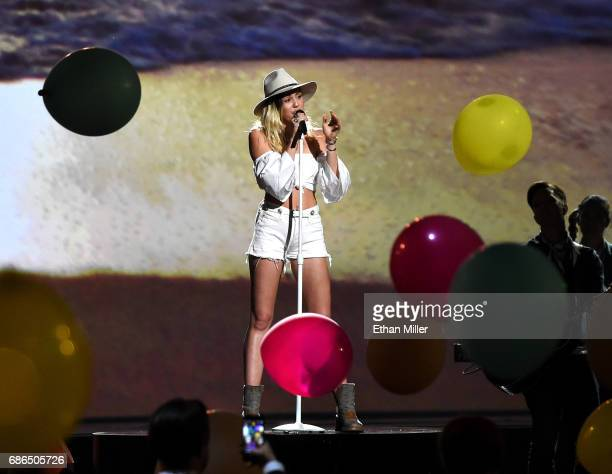 Singer Miley Cyrus performs onstage during the 2017 Billboard Music Awards at TMobile Arena on May 21 2017 in Las Vegas Nevada