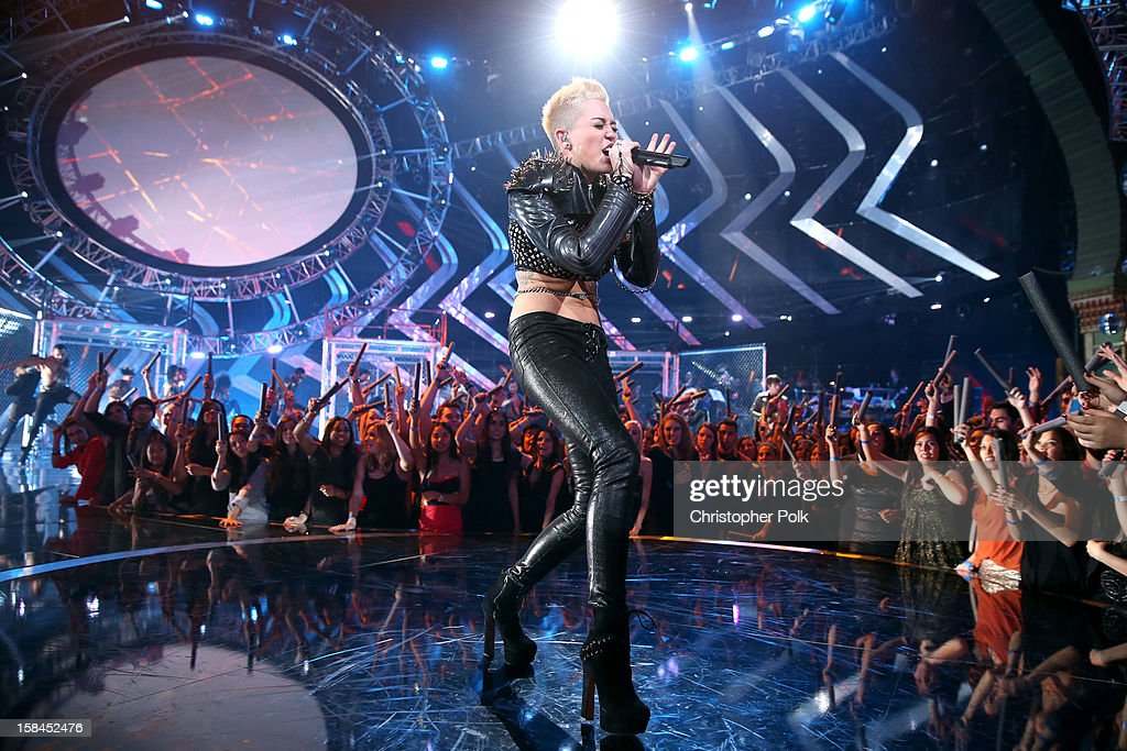Singer <a gi-track='captionPersonalityLinkClicked' href=/galleries/search?phrase=Miley+Cyrus&family=editorial&specificpeople=3973523 ng-click='$event.stopPropagation()'>Miley Cyrus</a> performs onstage during 'VH1 Divas' 2012 at The Shrine Auditorium on December 16, 2012 in Los Angeles, California.
