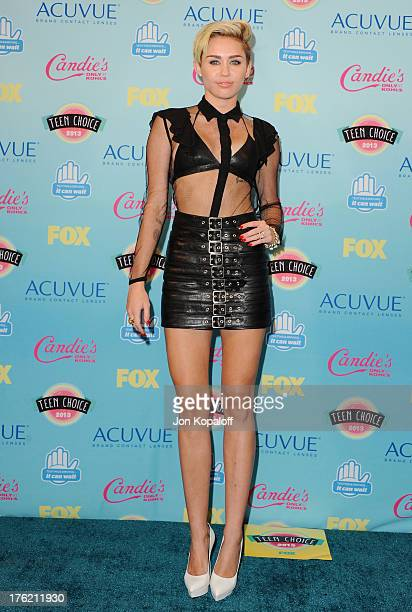 Singer Miley Cyrus poses in the press room at the 2013 Teen Choice Awards at Gibson Amphitheatre on August 11 2013 in Universal City California