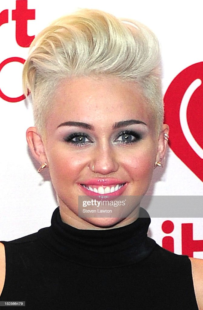 Singer Miley Cyrus poses in the press room at the iHeartRadio Music Festival at the MGM Grand Garden Arena September 21 2012 in Las Vegas Nevada