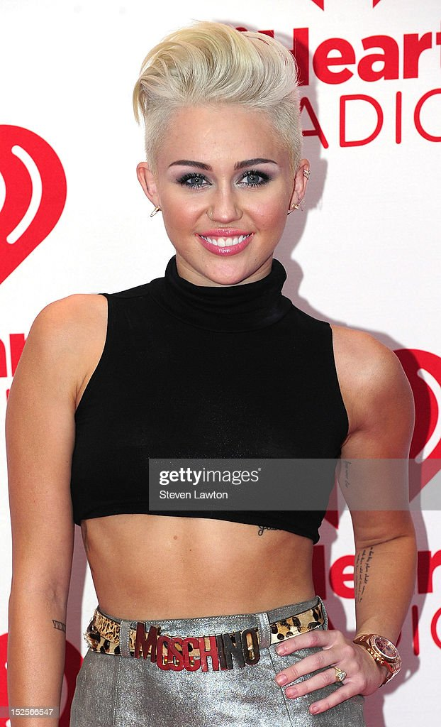 Singer <a gi-track='captionPersonalityLinkClicked' href=/galleries/search?phrase=Miley+Cyrus&family=editorial&specificpeople=3973523 ng-click='$event.stopPropagation()'>Miley Cyrus</a> poses in the press room at the iHeartRadio Music Festival at the MGM Grand Garden Arena September 21, 2012 in Las Vegas, Nevada.