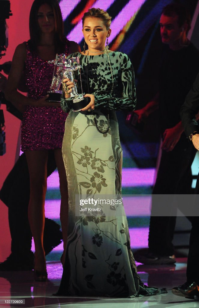 Singer Miley Cyrus speaks onstage during the 2011 MTV Video Music Awards at Nokia Theatre L.A. Live on August 28, 2011 in Los Angeles, California.