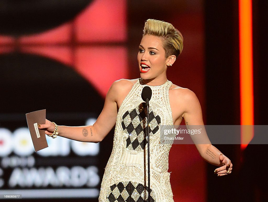 Singer Miley Cyrus speaks onstage during the 2013 Billboard Music Awards at the MGM Grand Garden Arena on May 19, 2013 in Las Vegas, Nevada.