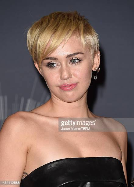 Singer Miley Cyrus winner of Video of the Year award for 'Wrecking Ball' poses in the press room during the 2014 MTV Video Music Awards at The Forum...
