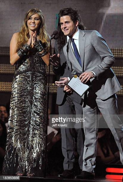 Singer Miley Cyrus with musician Jared Followill of Kings of Leon speak onstage during The 53rd Annual GRAMMY Awards held at Staples Center on...