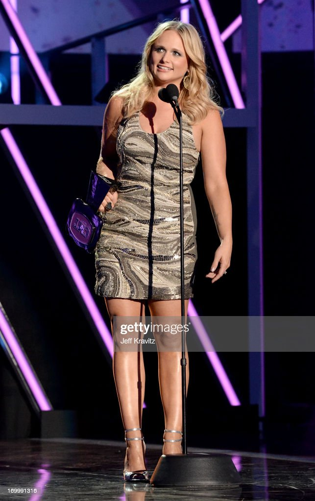 Singer <a gi-track='captionPersonalityLinkClicked' href=/galleries/search?phrase=Miranda+Lambert&family=editorial&specificpeople=571972 ng-click='$event.stopPropagation()'>Miranda Lambert</a> accepts an award onstage at the 2013 CMT Music Awards at the Bridgestone Arena on June 5, 2013 in Nashville, Tennessee.
