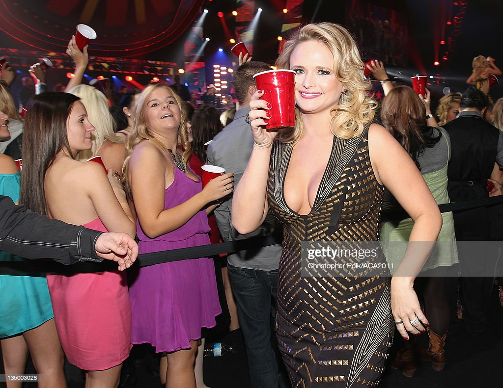 Singer <a gi-track='captionPersonalityLinkClicked' href=/galleries/search?phrase=Miranda+Lambert&family=editorial&specificpeople=571972 ng-click='$event.stopPropagation()'>Miranda Lambert</a> (R) attends the American Country Awards 2011 at the MGM Grand Garden Arena on December 5, 2011 in Las Vegas, Nevada.