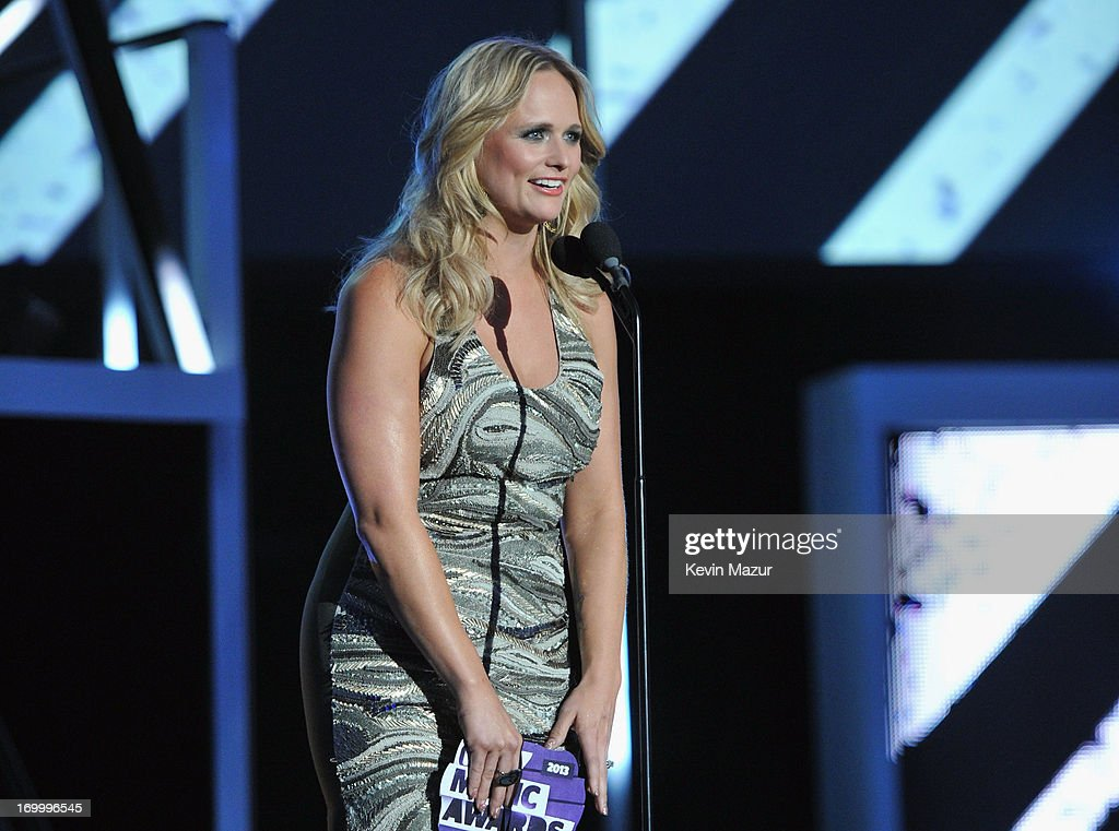 Singer <a gi-track='captionPersonalityLinkClicked' href=/galleries/search?phrase=Miranda+Lambert&family=editorial&specificpeople=571972 ng-click='$event.stopPropagation()'>Miranda Lambert</a> presents an award during the 2013 CMT Music awards at the Bridgestone Arena on June 5, 2013 in Nashville, Tennessee.