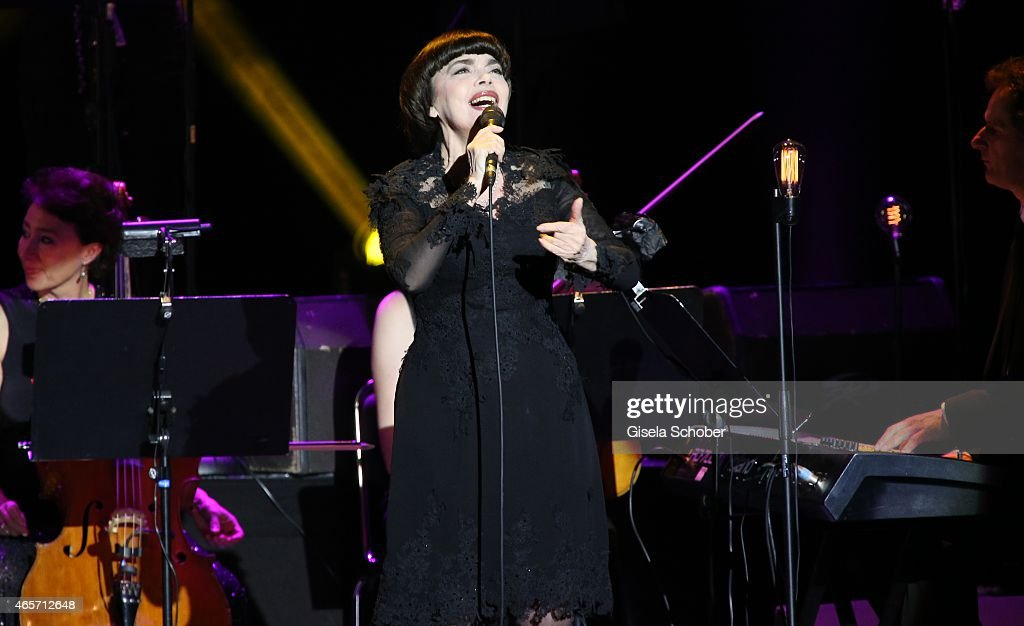 Singer <a gi-track='captionPersonalityLinkClicked' href=/galleries/search?phrase=Mireille+Mathieu&family=editorial&specificpeople=738659 ng-click='$event.stopPropagation()'>Mireille Mathieu</a> performs live on stage at Deutsches Theatre on March 9, 2015 in Munich, Germany.