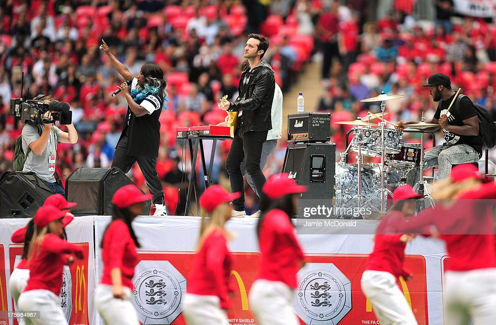 Singer Misha B performs ahead of the FA Community Shield match between Manchester United and Wigan Athletic at Wembley Stadium on August 11 2013 in...