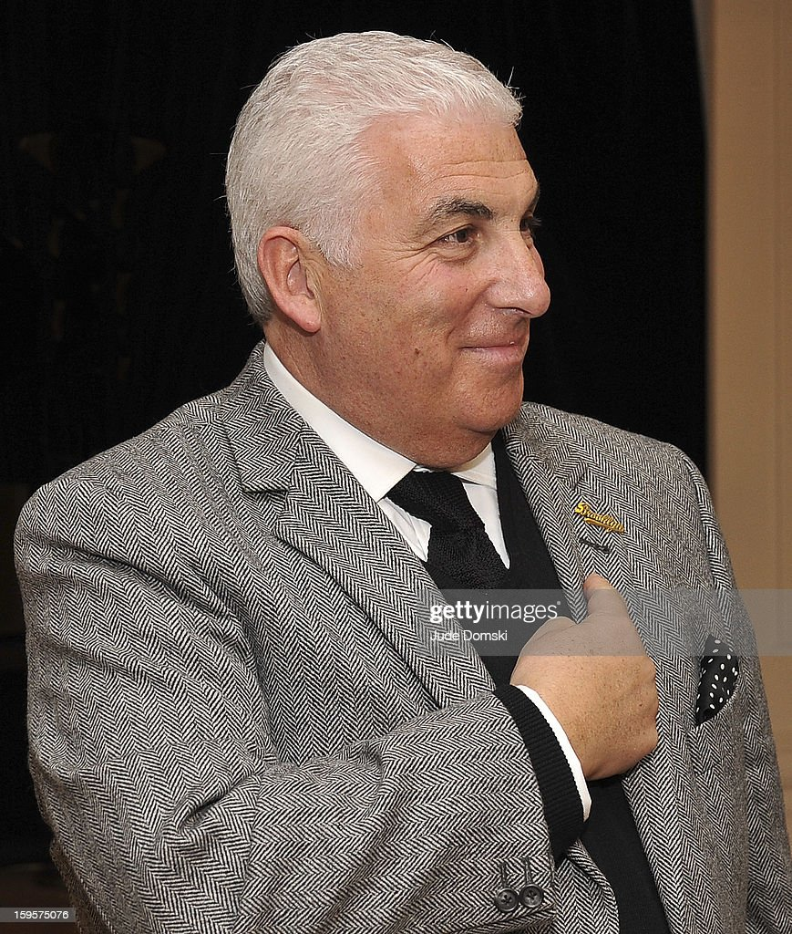 Singer Mitch Winehouse, father of the late singer Amy Winehosue, pointing to a Brooklyn lapel pin at the Amy Winehouse Foundation grant presentation at the Brooklyn Conservatory of Music on January 16, 2013 in the Brooklyn borough of New York City.