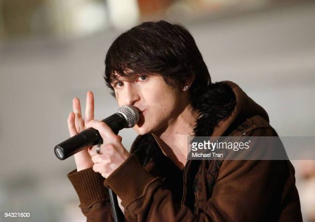 Singer Mitchel Musso performs onstage at 'The 12 Days of Shopping' free holiday concert held at Westfield Culver City Shopping Mall on December 11...