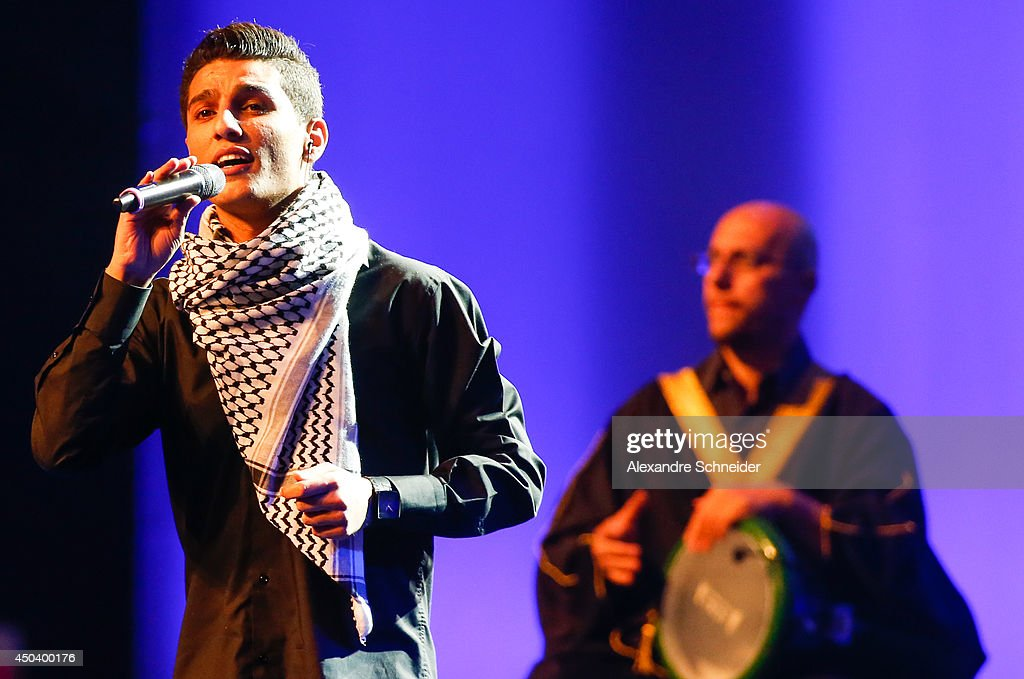 Singer <a gi-track='captionPersonalityLinkClicked' href=/galleries/search?phrase=Mohammed+Assaf&family=editorial&specificpeople=10886300 ng-click='$event.stopPropagation()'>Mohammed Assaf</a> performs during the opening ceremony of the 64th FIFA Congress at the Expocenter Transamerica on June 10, 2014 in Sao Paulo, Brazil.