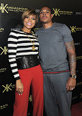 Singer Monica and professional basketball player Shannon Brown arrive at the Kardashian Kollection launch party at The Colony on August 17 2011 in...