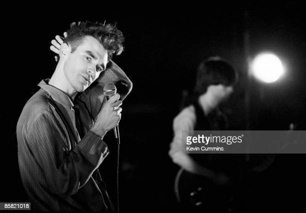 Singer Morrissey and guitarist Johnny Marr of The Smiths performing at Sheffield University South Yorkshire 31st January 1984