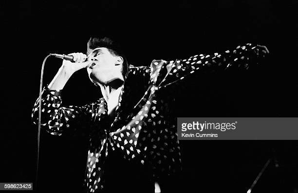 Singer Morrissey performing with English pop group The Smiths at the Palace Theatre Manchester 31st March 1985