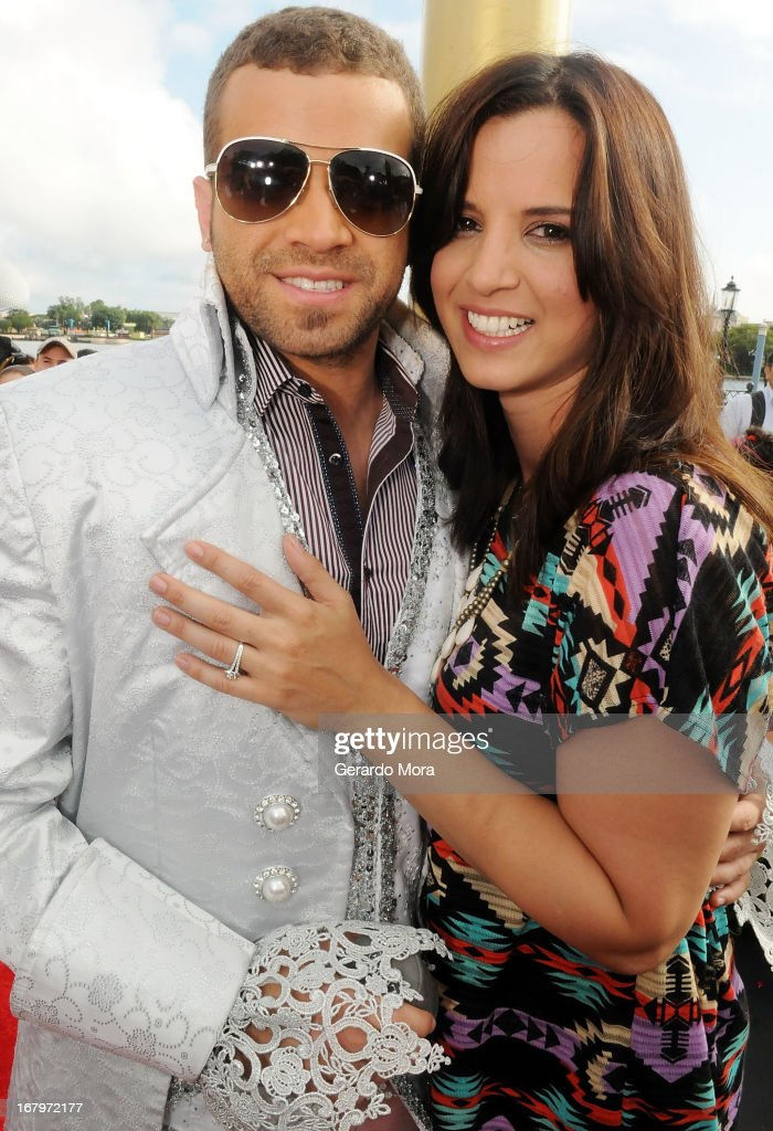Singer Nacho (L) and his girlfriend Chompy pose after propose marriage during Univision's morning show Despierta America 16th anniversary at Epcot Center Walt Disney World on May 3, 2013 in Orlando, Florida.