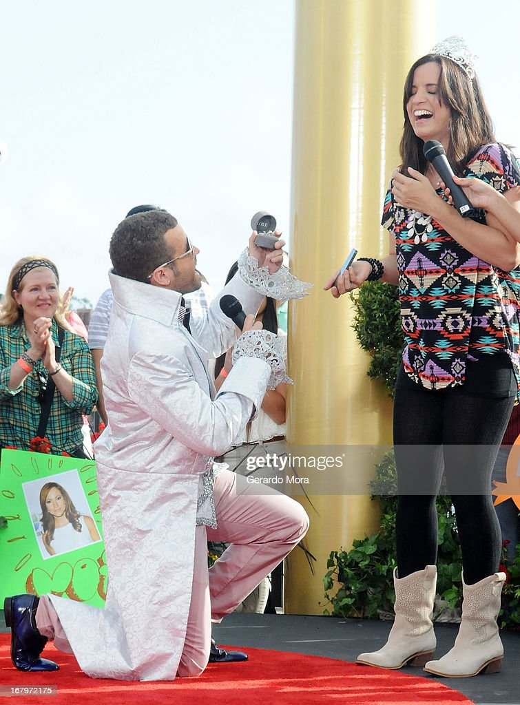 Singer Nacho (L) proposes marriage to his girlfriend Chompy during Univision's morning show Despierta America 16th anniversary at Epcot Center Walt Disney World on May 3, 2013 in Orlando, Florida.