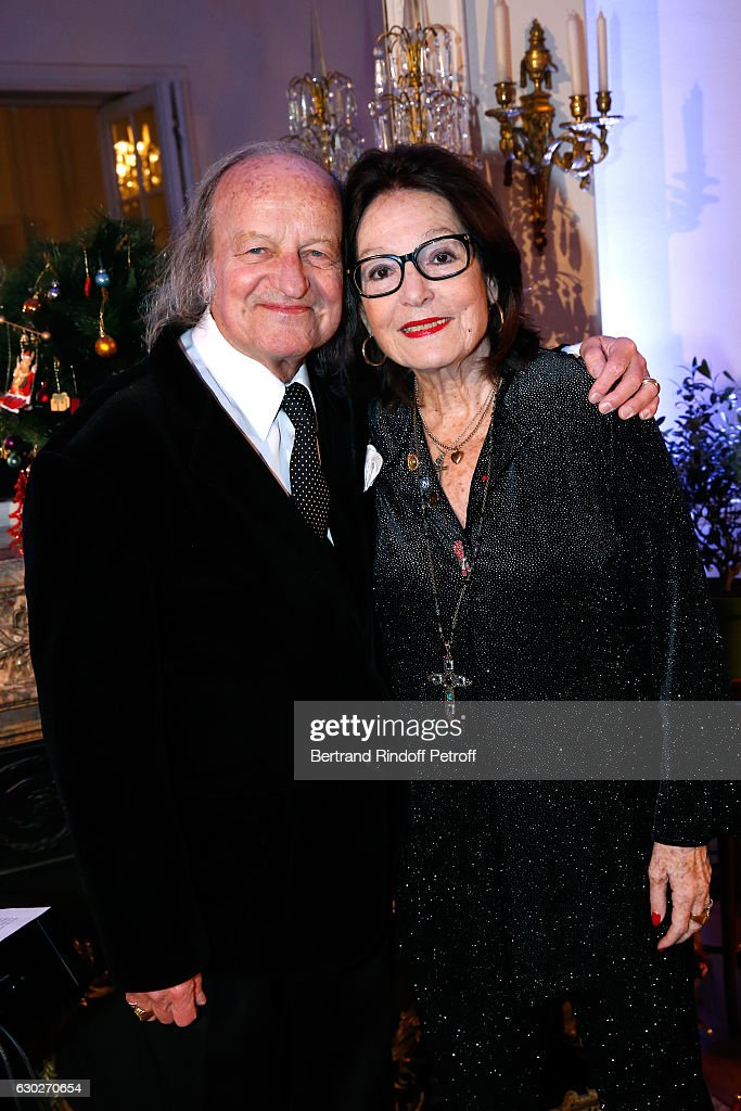 Singer Nana Mouskouri and her husband Andre Chapelle attend Nana Mouskouri gives the Greek Prize 'Nikos Gatsos 2016' to Charles Aznavour at Embassy of Greece on December 19, 2016 in Paris, France.